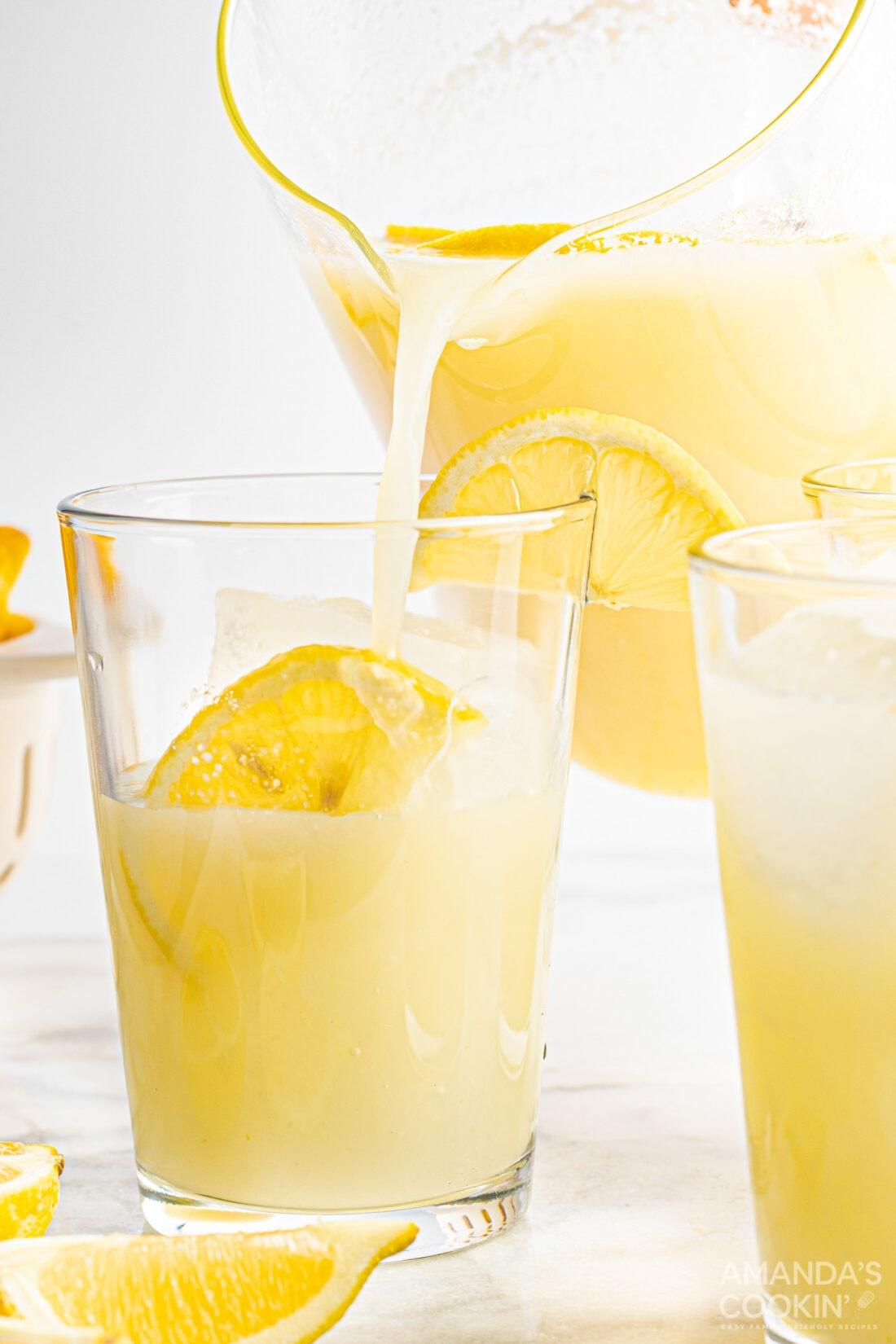 pouring a glass of Frozen Lemonade