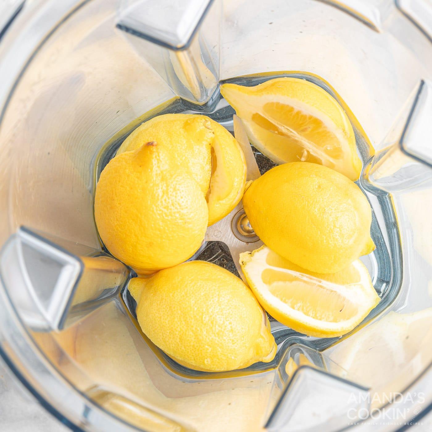 halved lemons in a blender