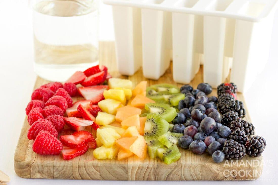 chopped fruit on a cutting board