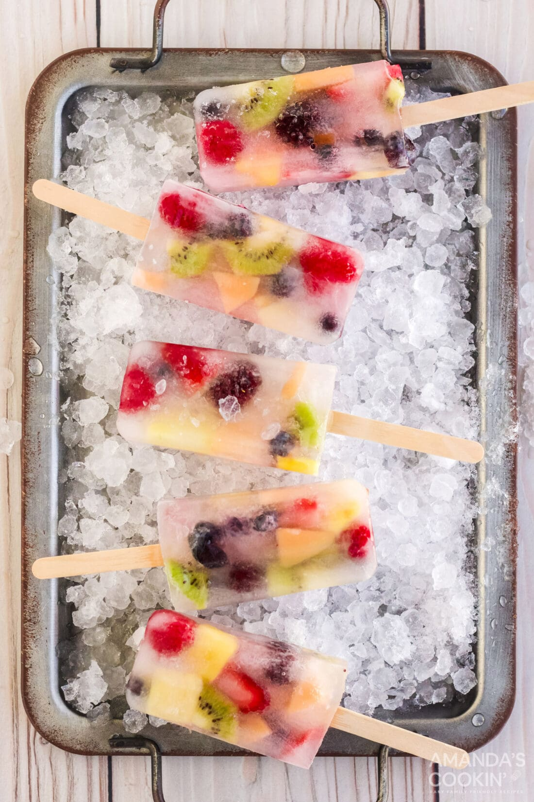 Fruit Popsicles on a tray of ice cubes