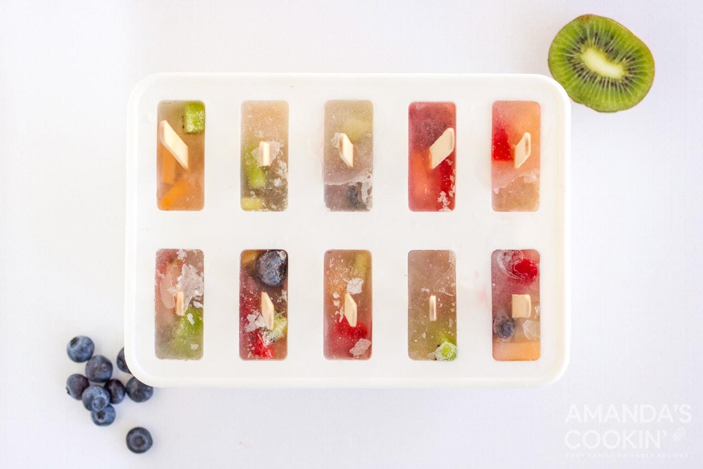 frozen fruit popsicles in a mold