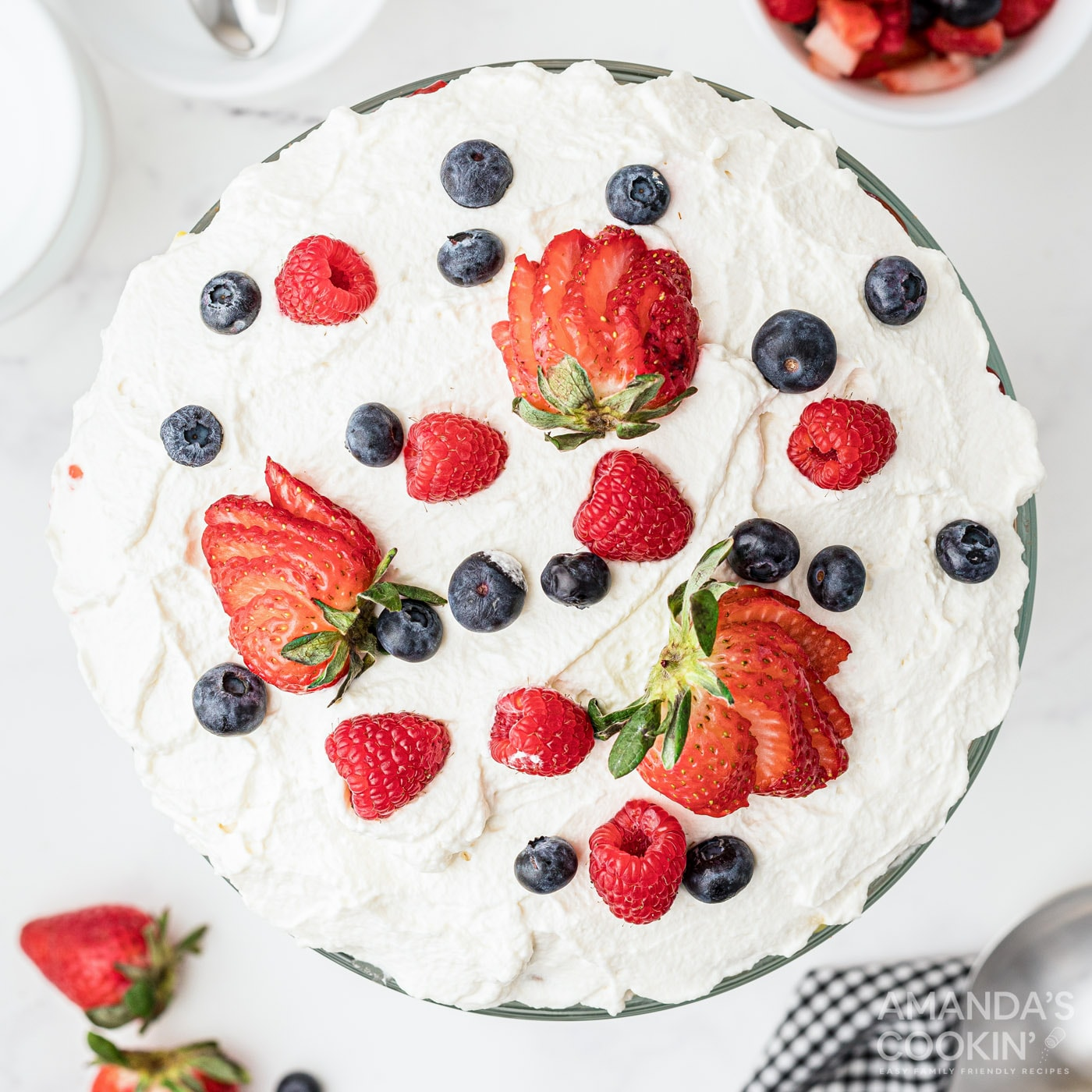 whipped cream and berries on top of trifle