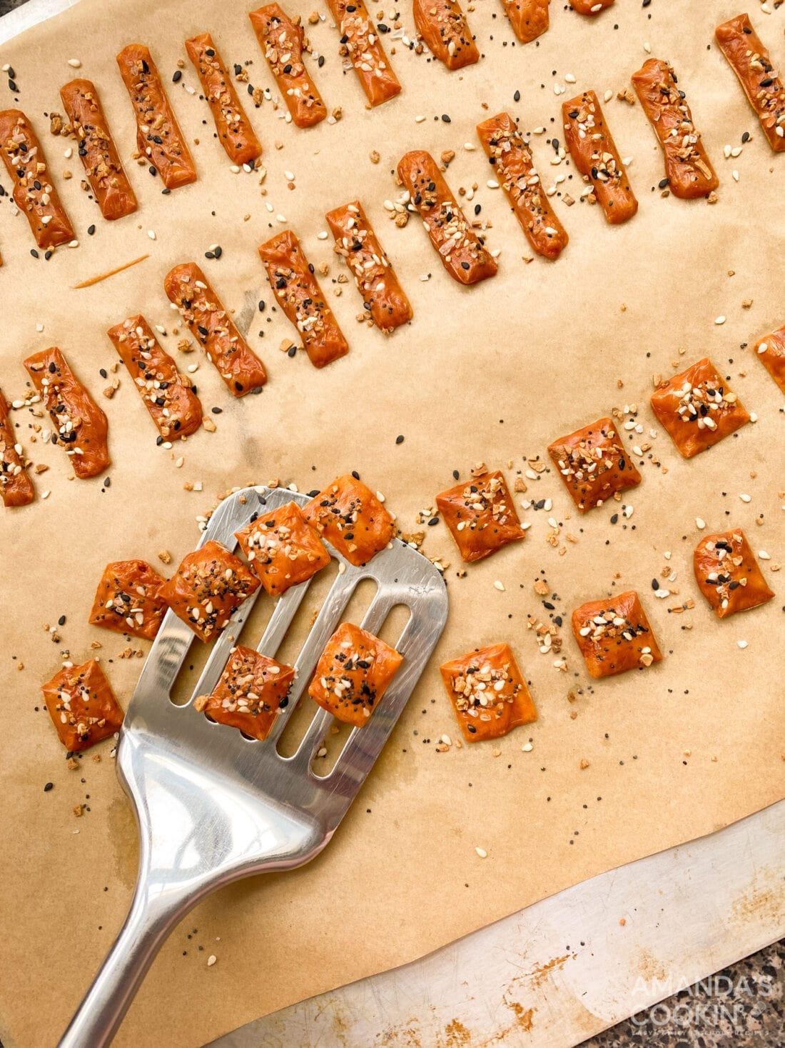 spatula lifting keto cheese crackers from baking sheet