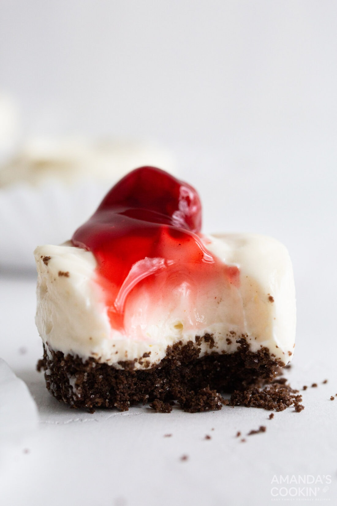 mini cheesecake with a bite out of it