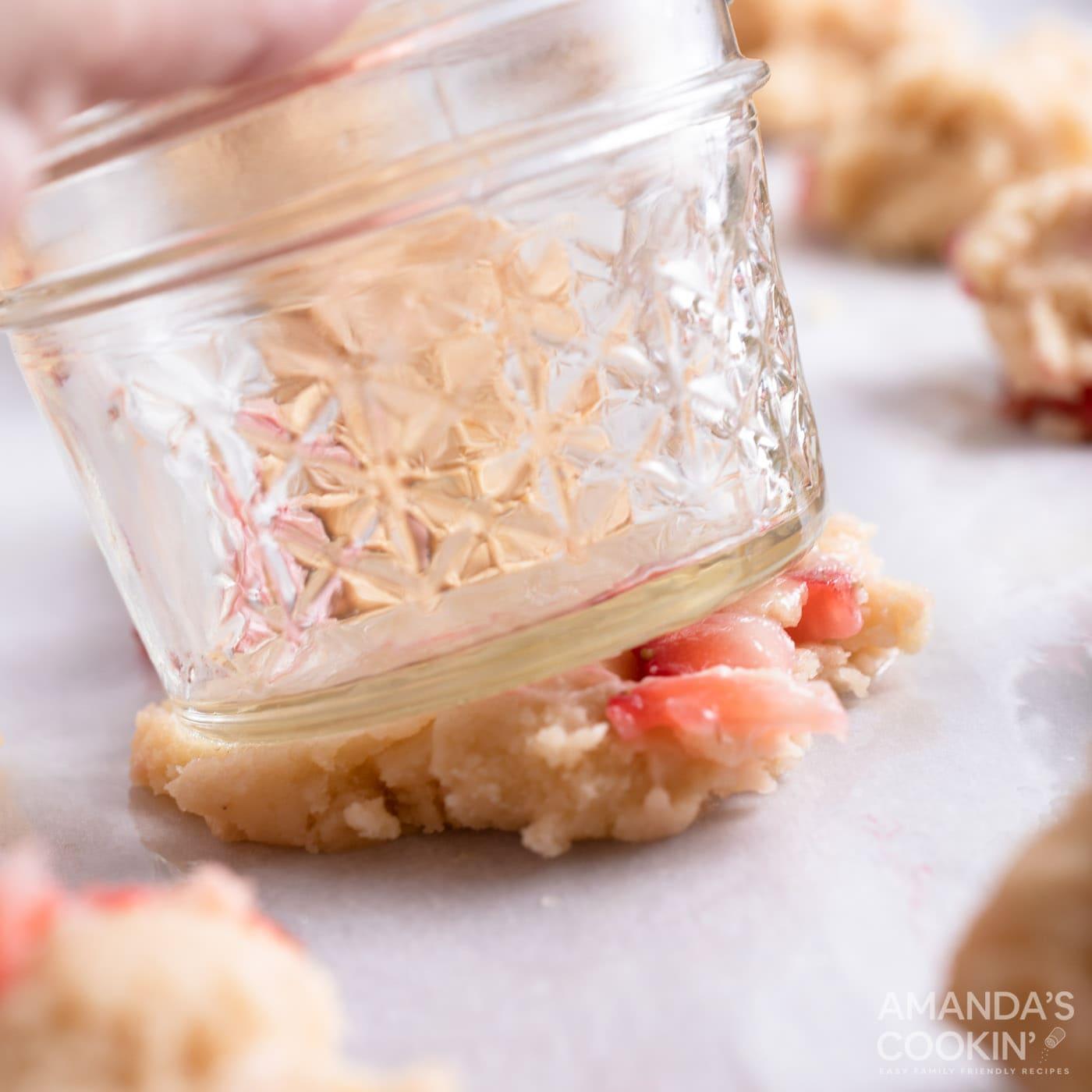 using a mason jar to flatten cookie dough balls
