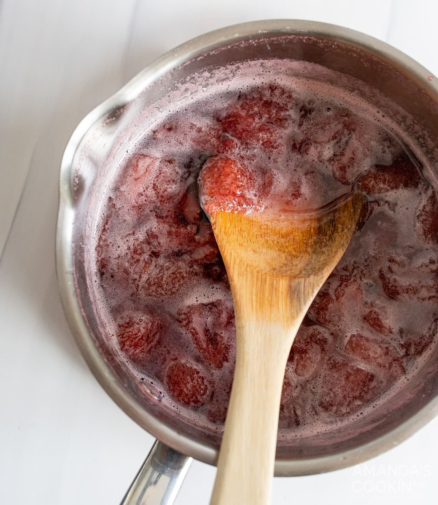 strawberry simple syrup in a saucepan