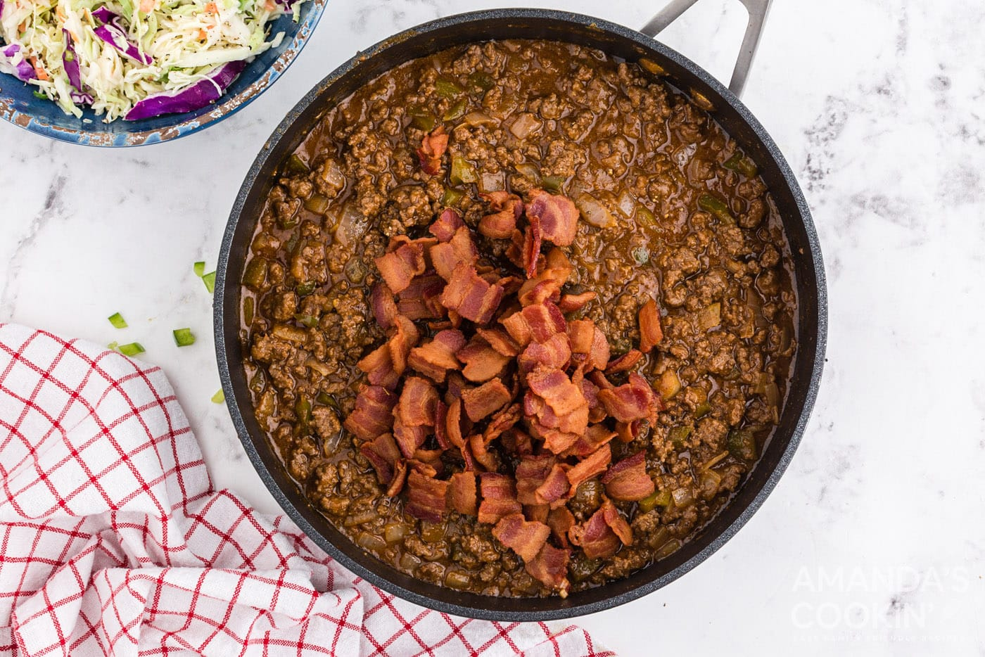 bacon in pan with ground beef