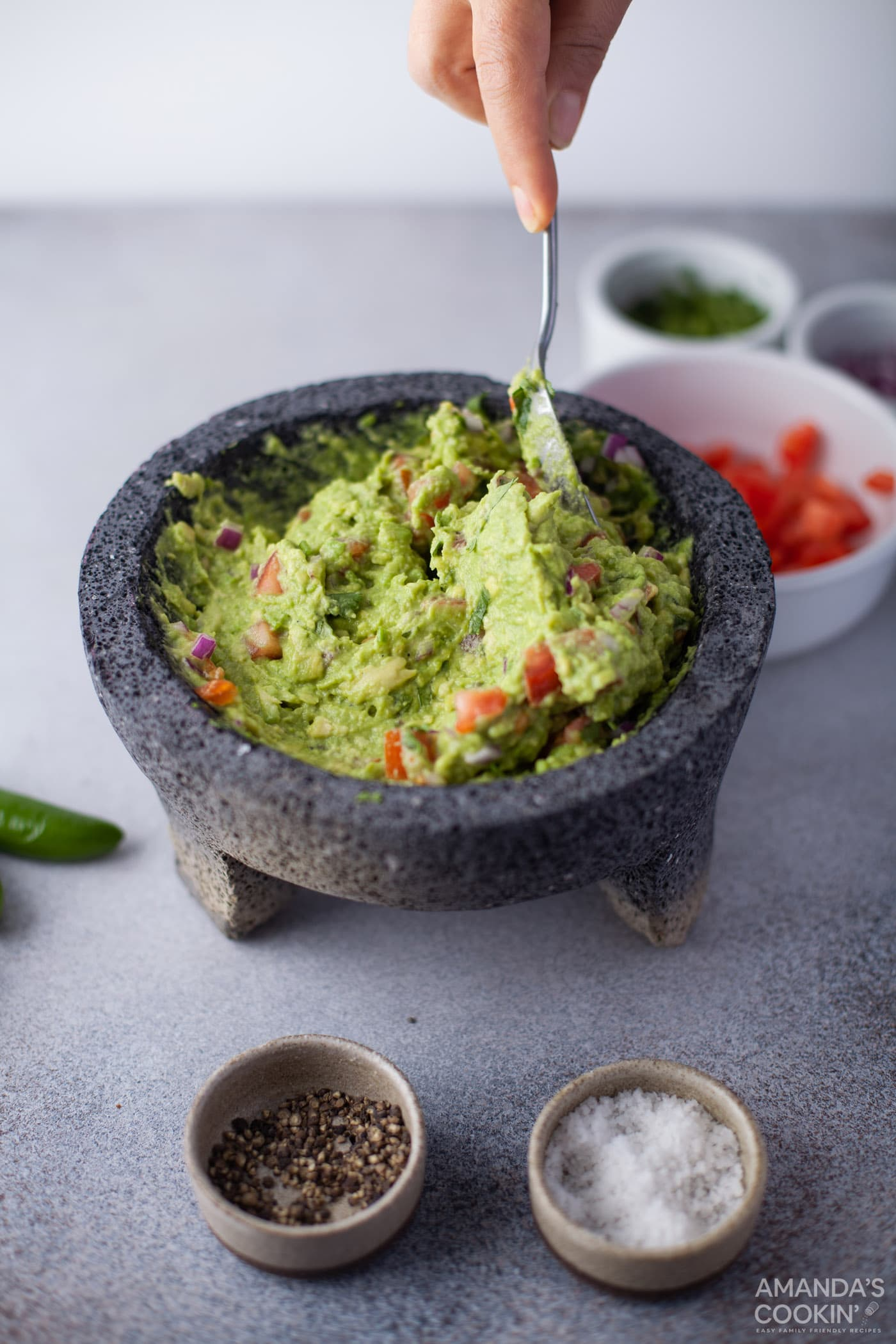 mixing guacamole with a spoon