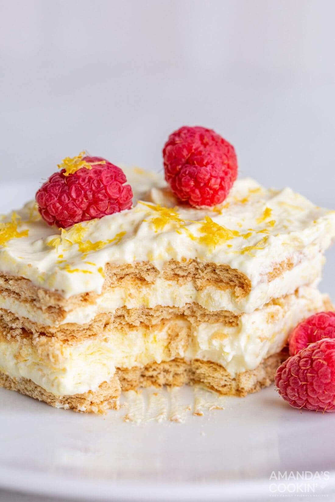 lemon icebox cake with bites out of it
