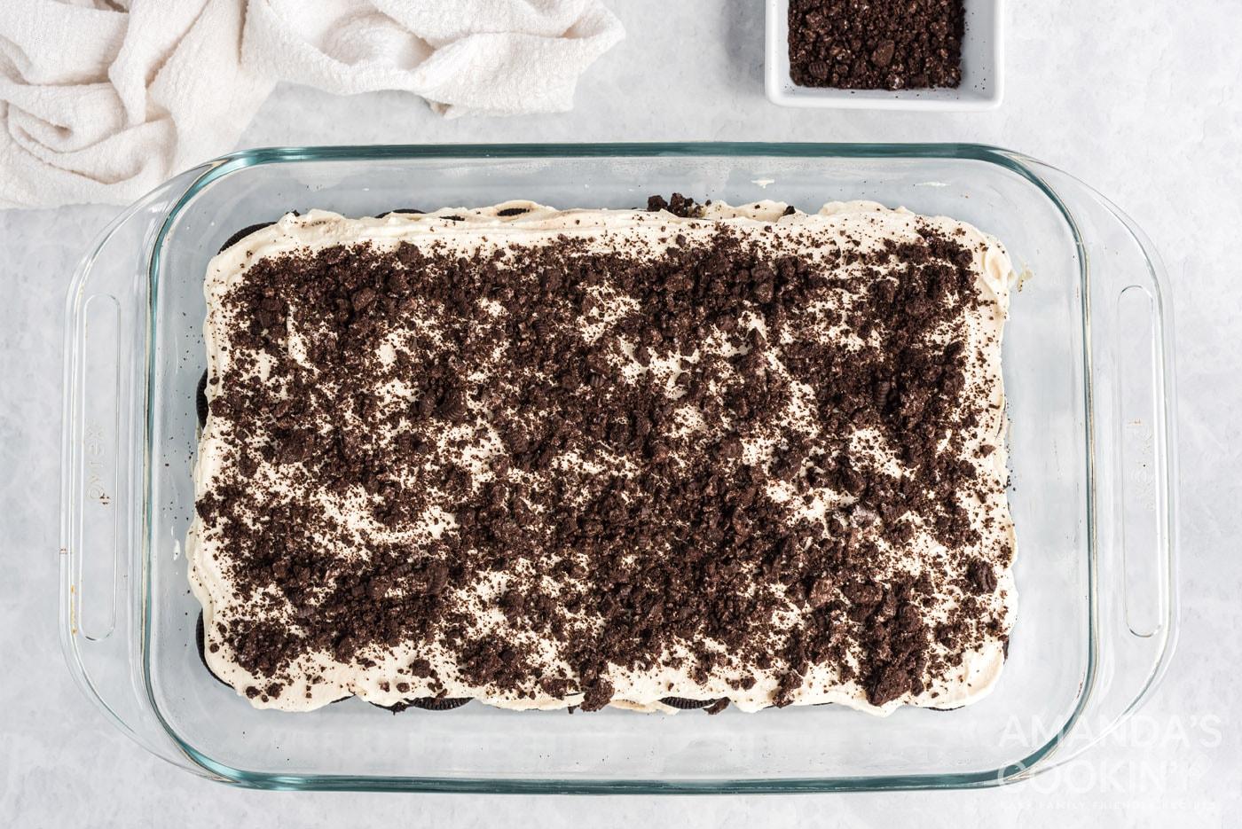crushed Oreos on top of oreo icebox cake