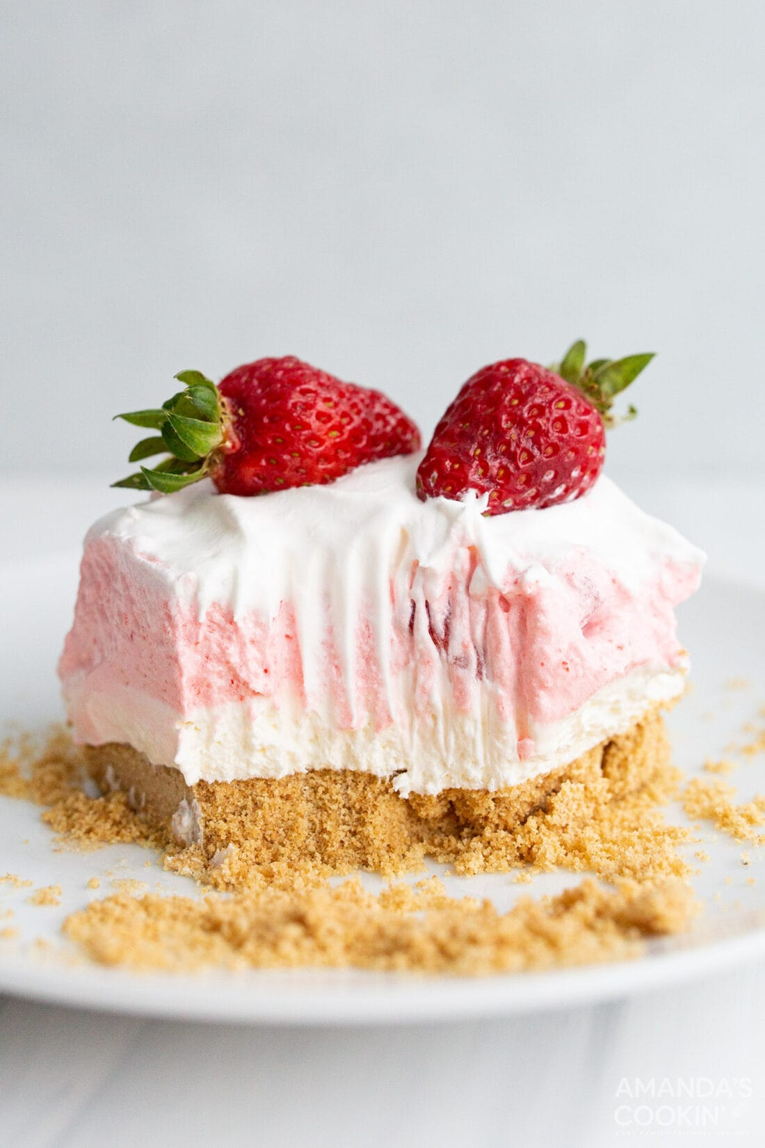 slice of Strawberry Lasagna with bites removed
