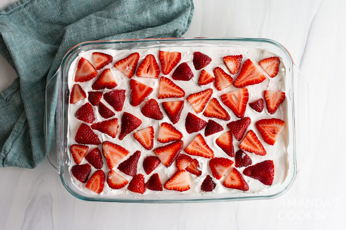sliced strawberries on top of dessert in a baking dish
