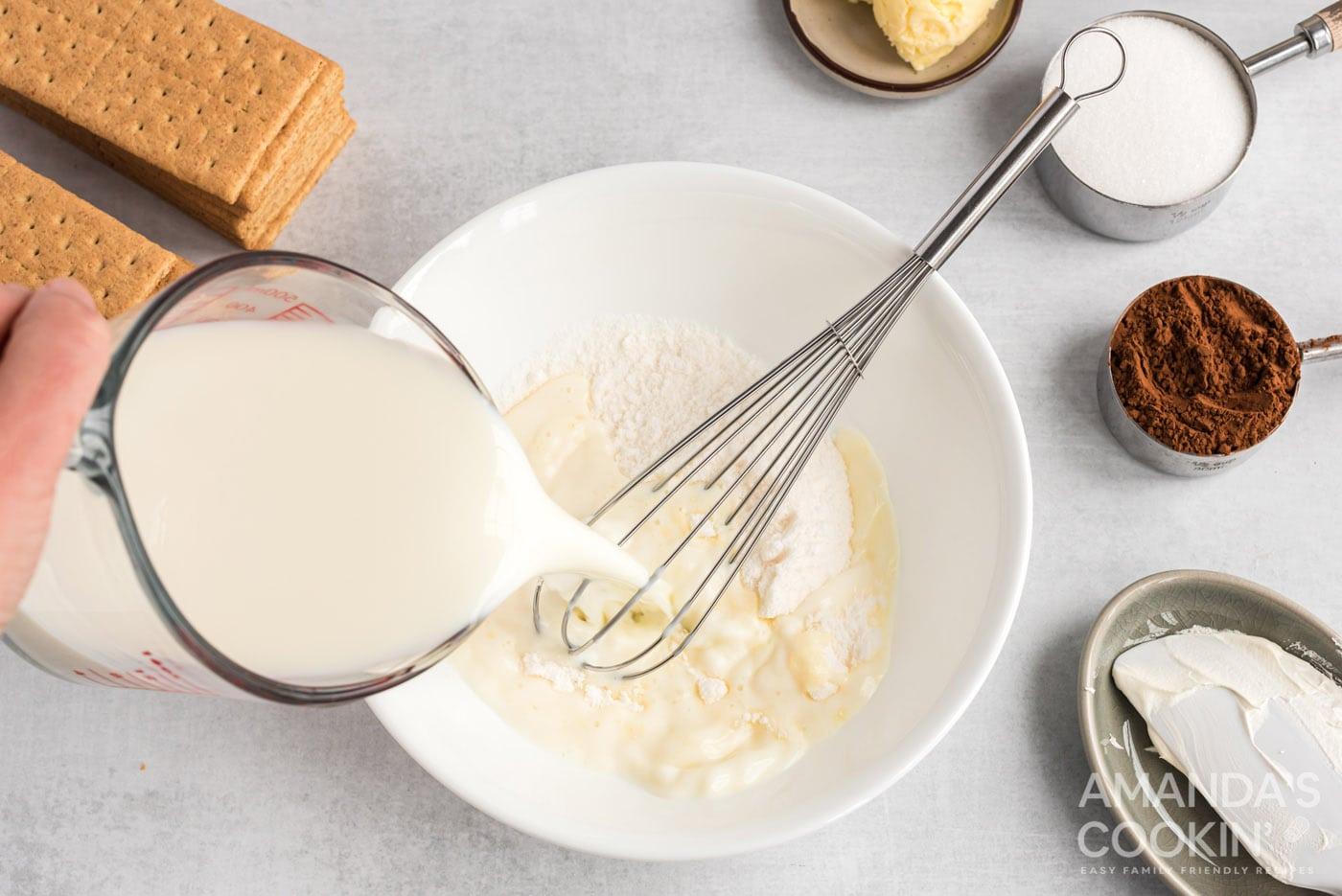 milk pouring into pudding powder
