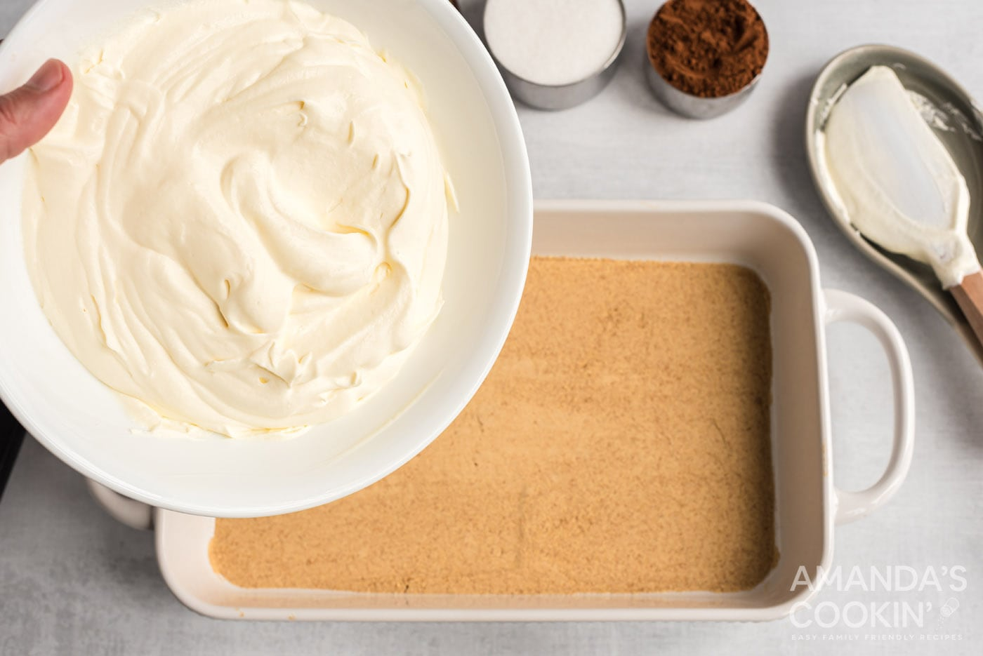 pour pudding mixture over the top of the graham cracker layer