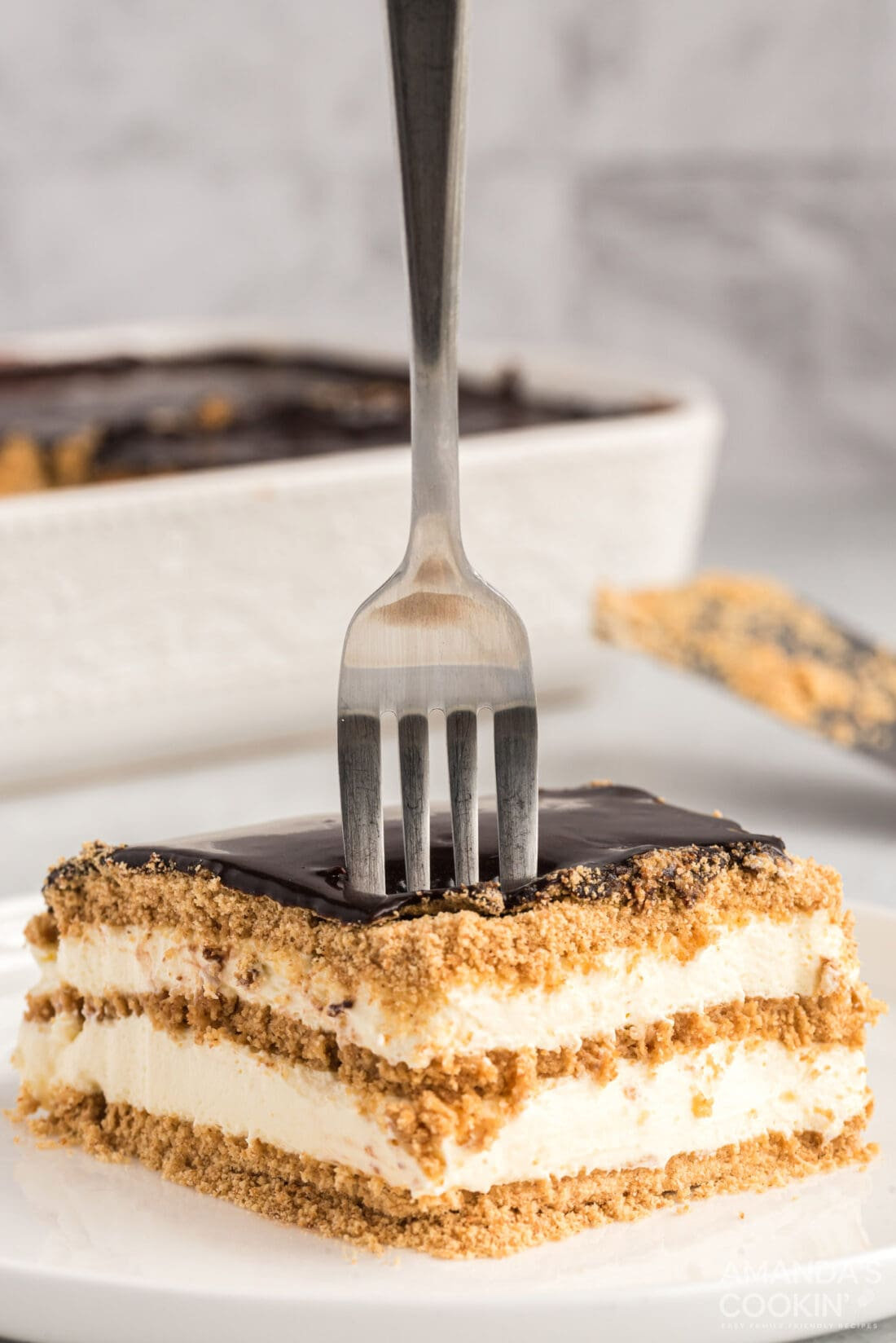fork stuck into eclair cake