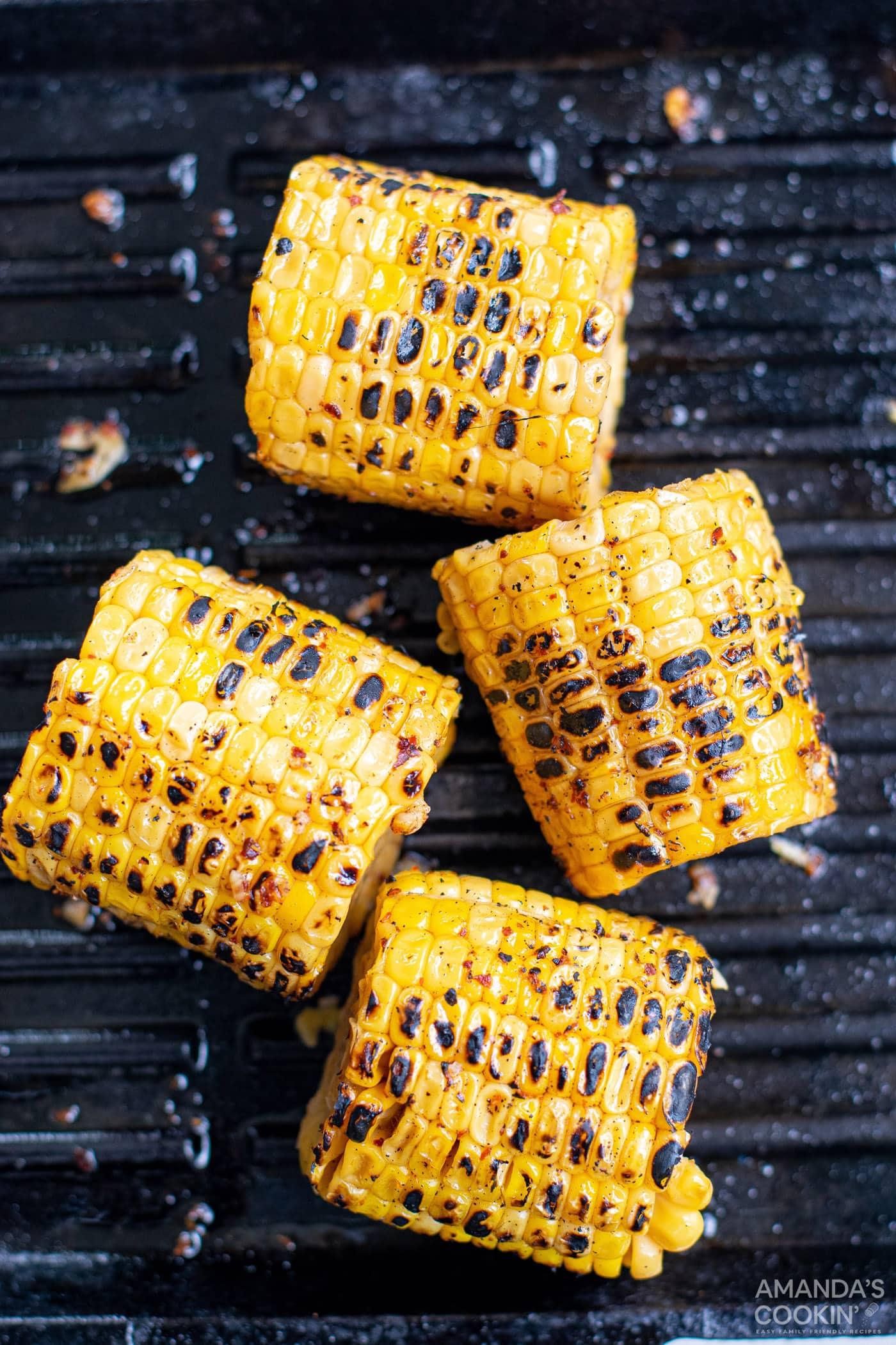 charred corn cobs on grill