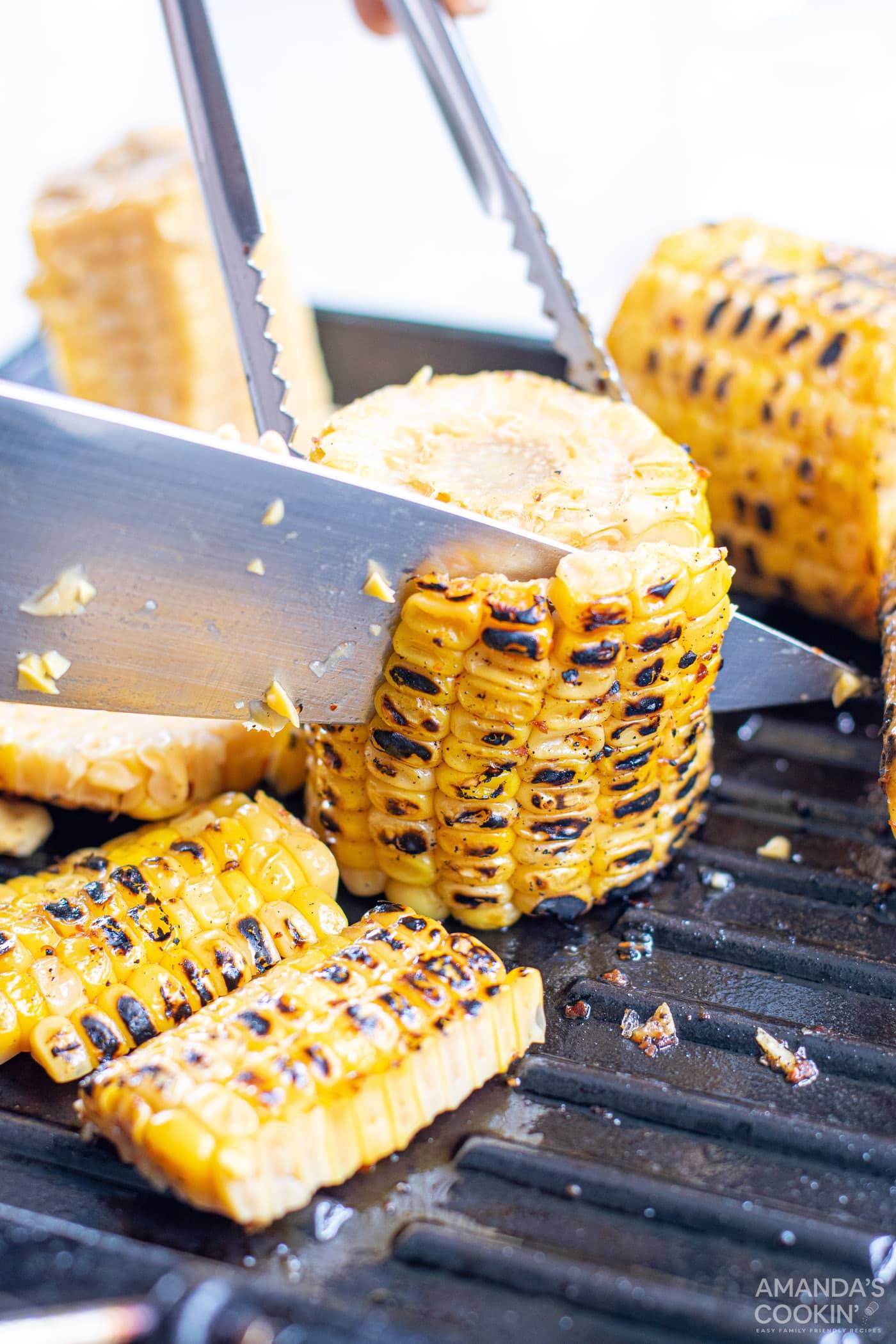 knife cutting corn off the cob