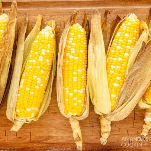 corn on the cob with husks on