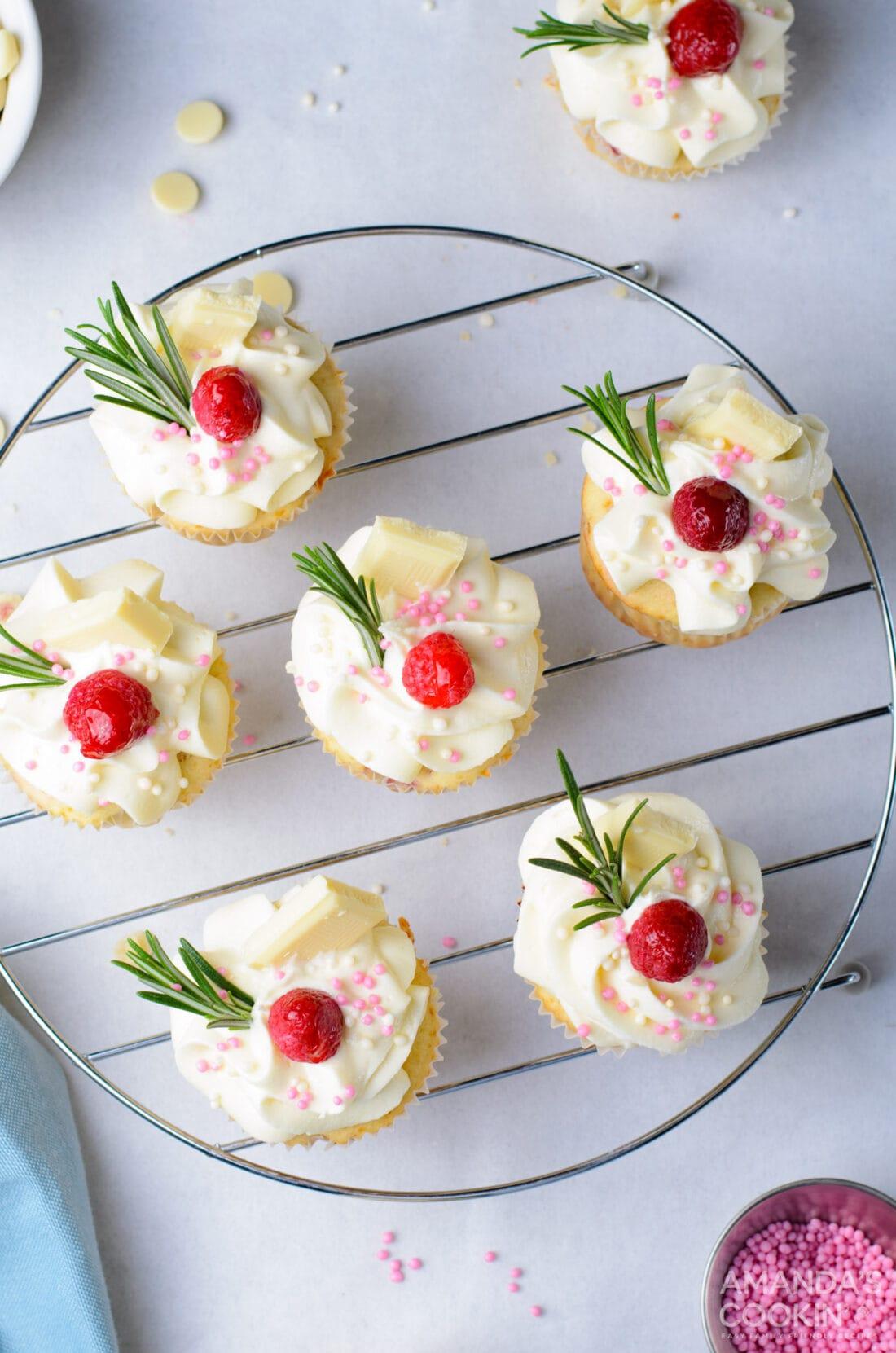 overhead photo of Raspberry White Chocolate Cupcakes on a rack