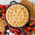 smores dip in a cast iron skillet