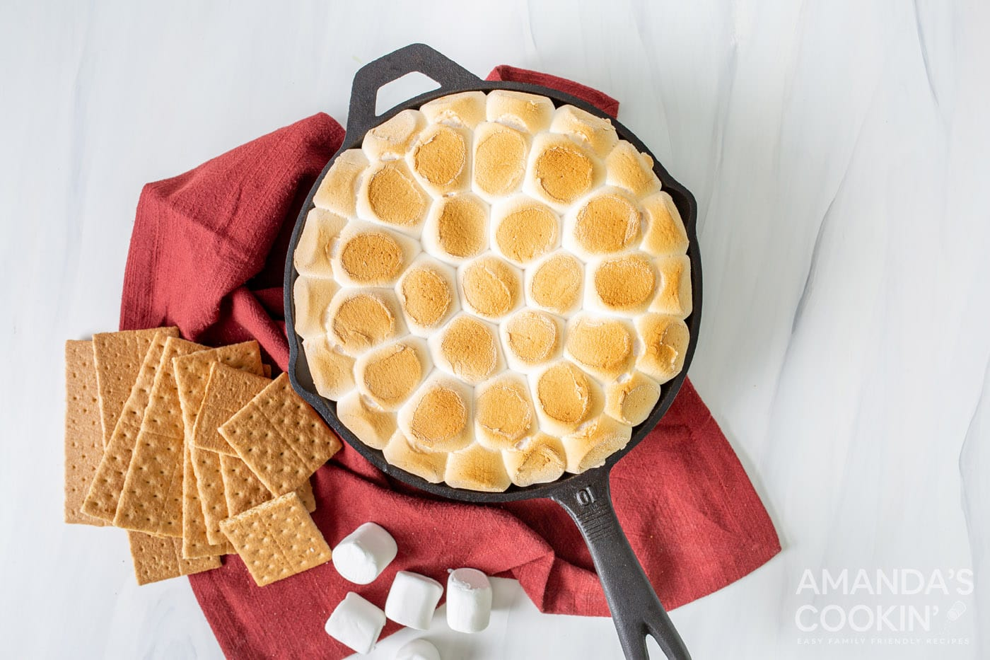 smores dip in a cast iron skillet overhead shot