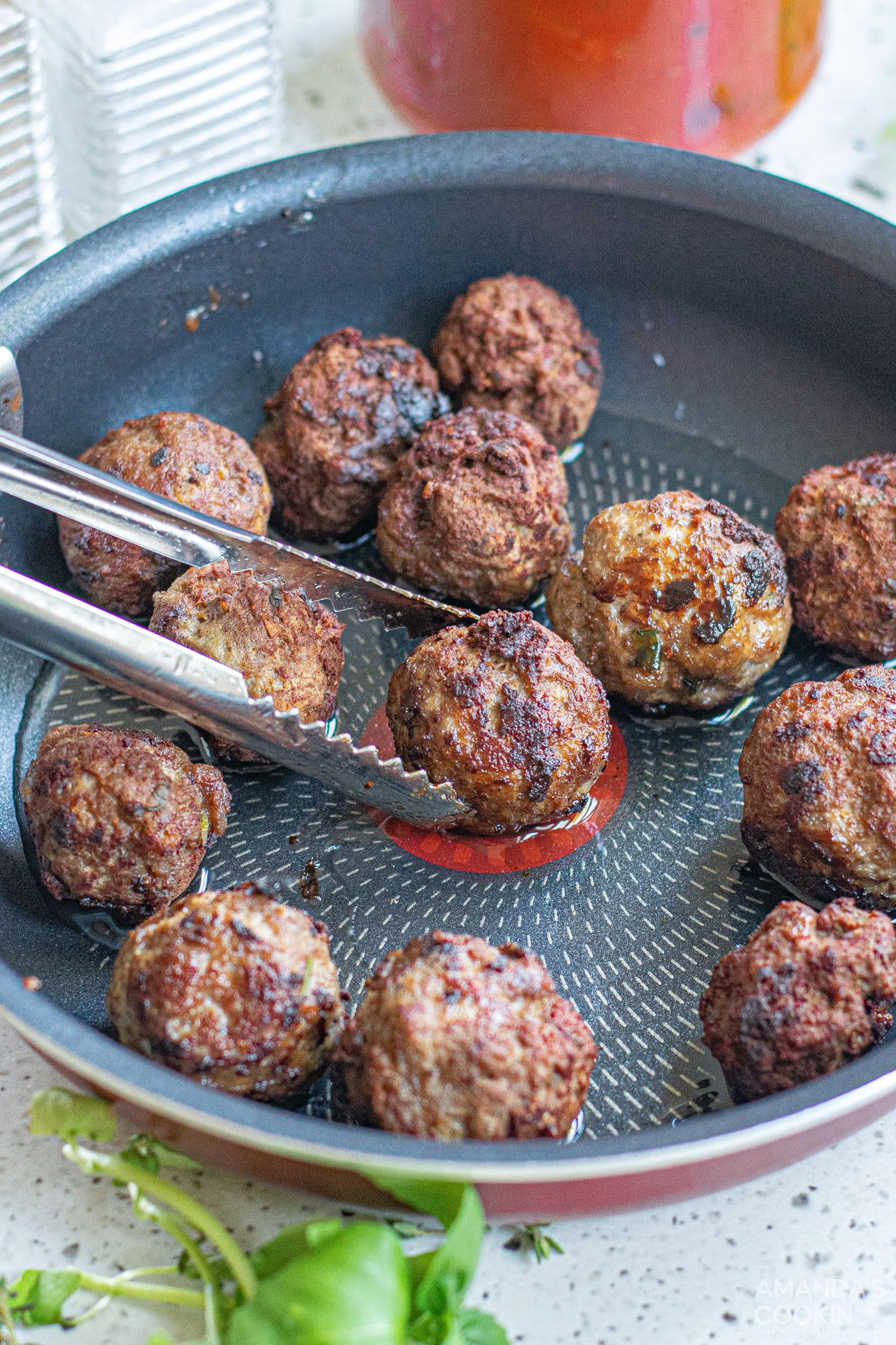 browning meatballs on a skillet