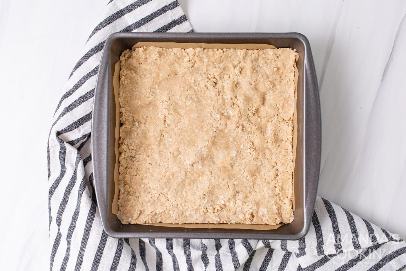 rhubarb crumble bars crust in a pan