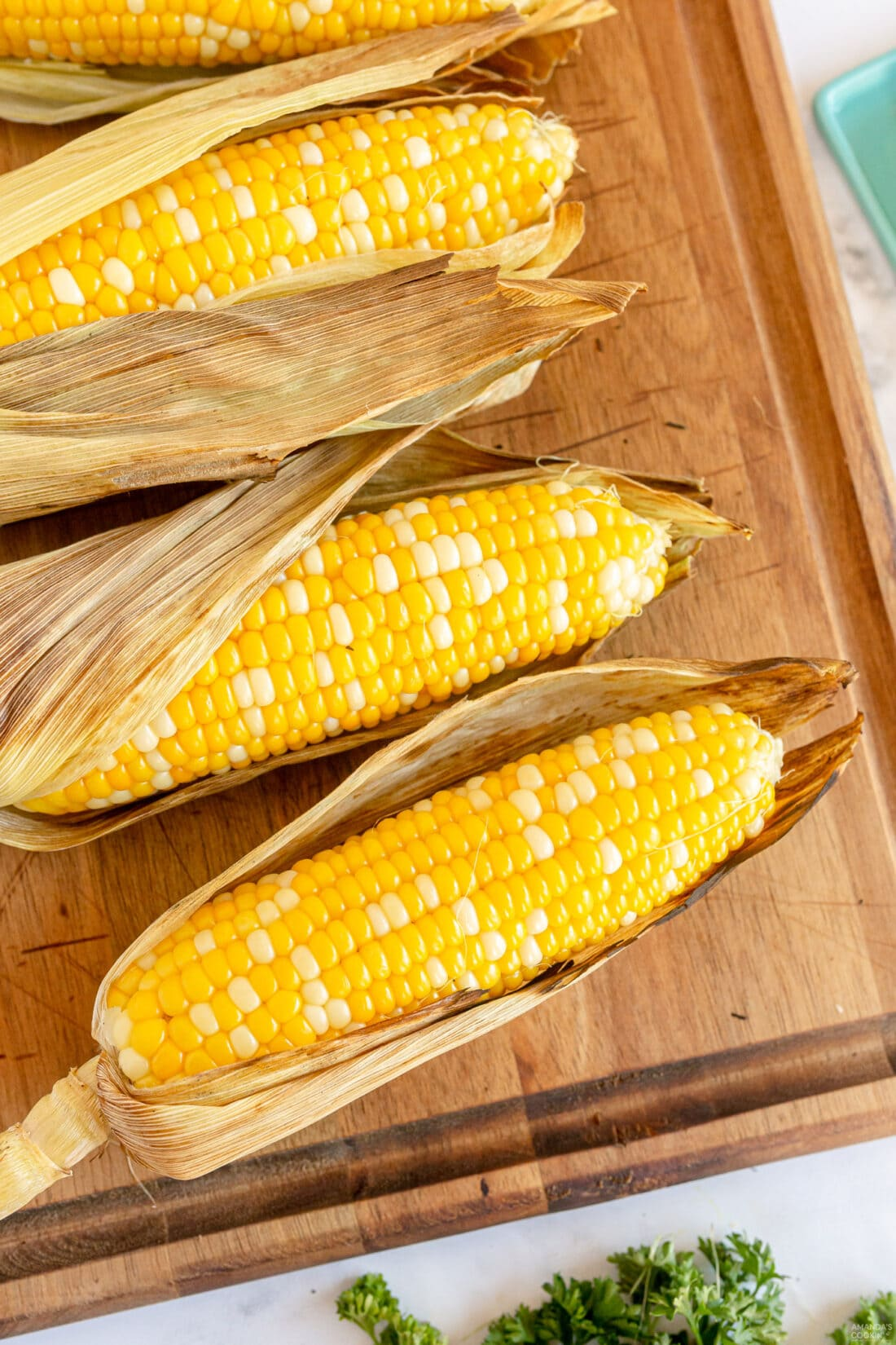 Grilled Corn on the Cob with husks on