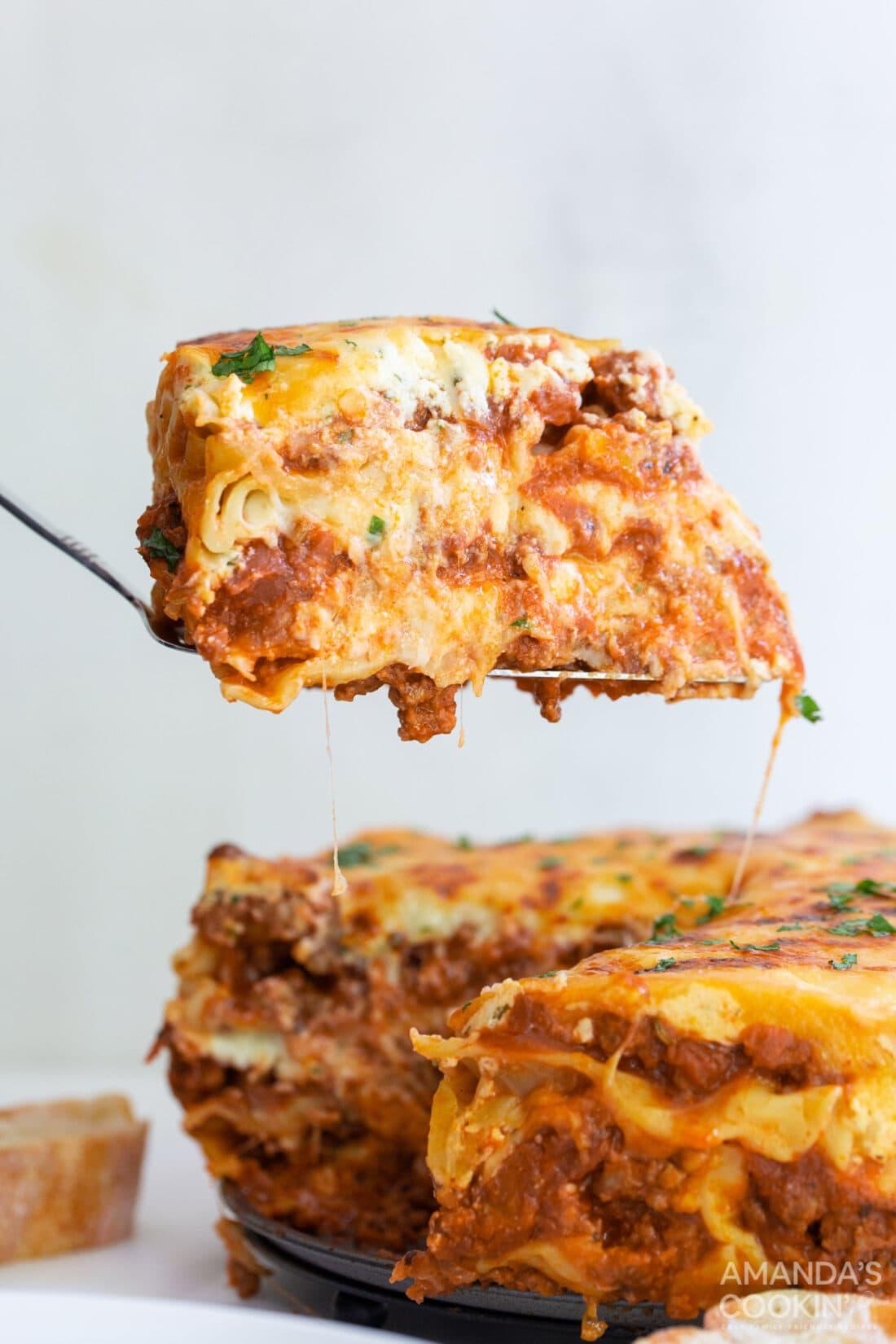 spatula lifting slice of Instant Pot Lasagna