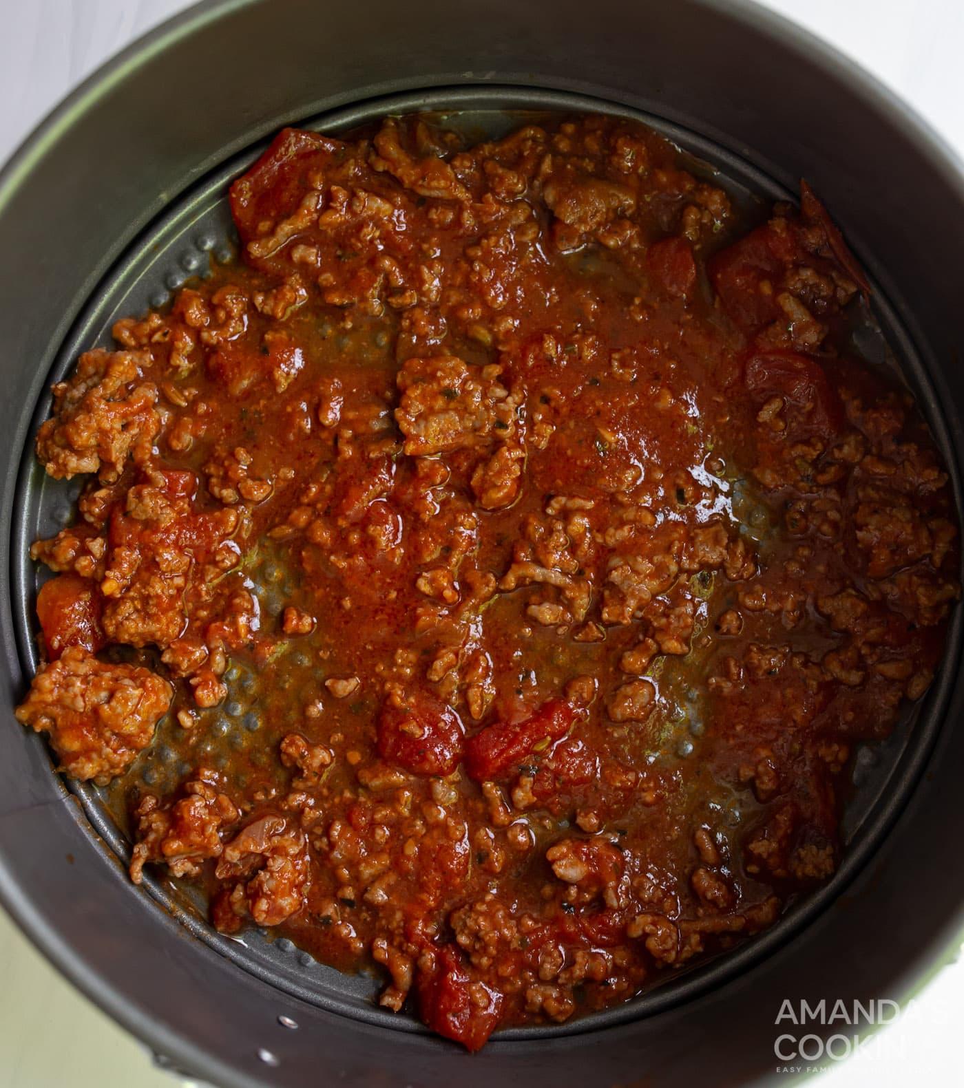 meat sauce in springform pan