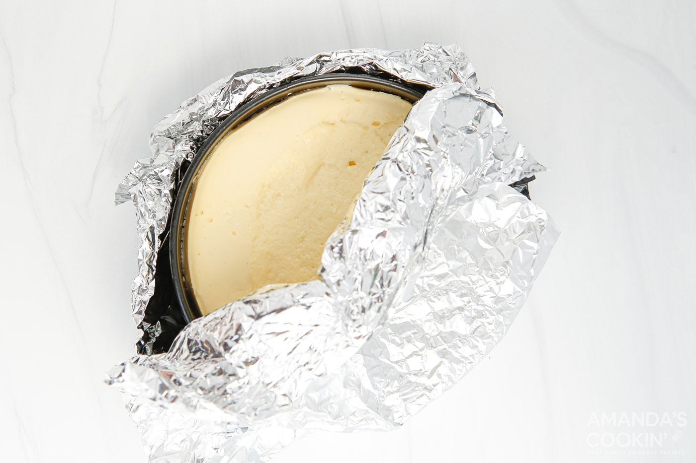 cheesecake wrapped in aluminum foil