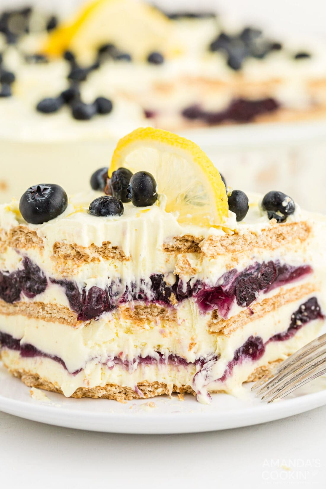 Lemon Blueberry Icebox Cake with a bite out of it