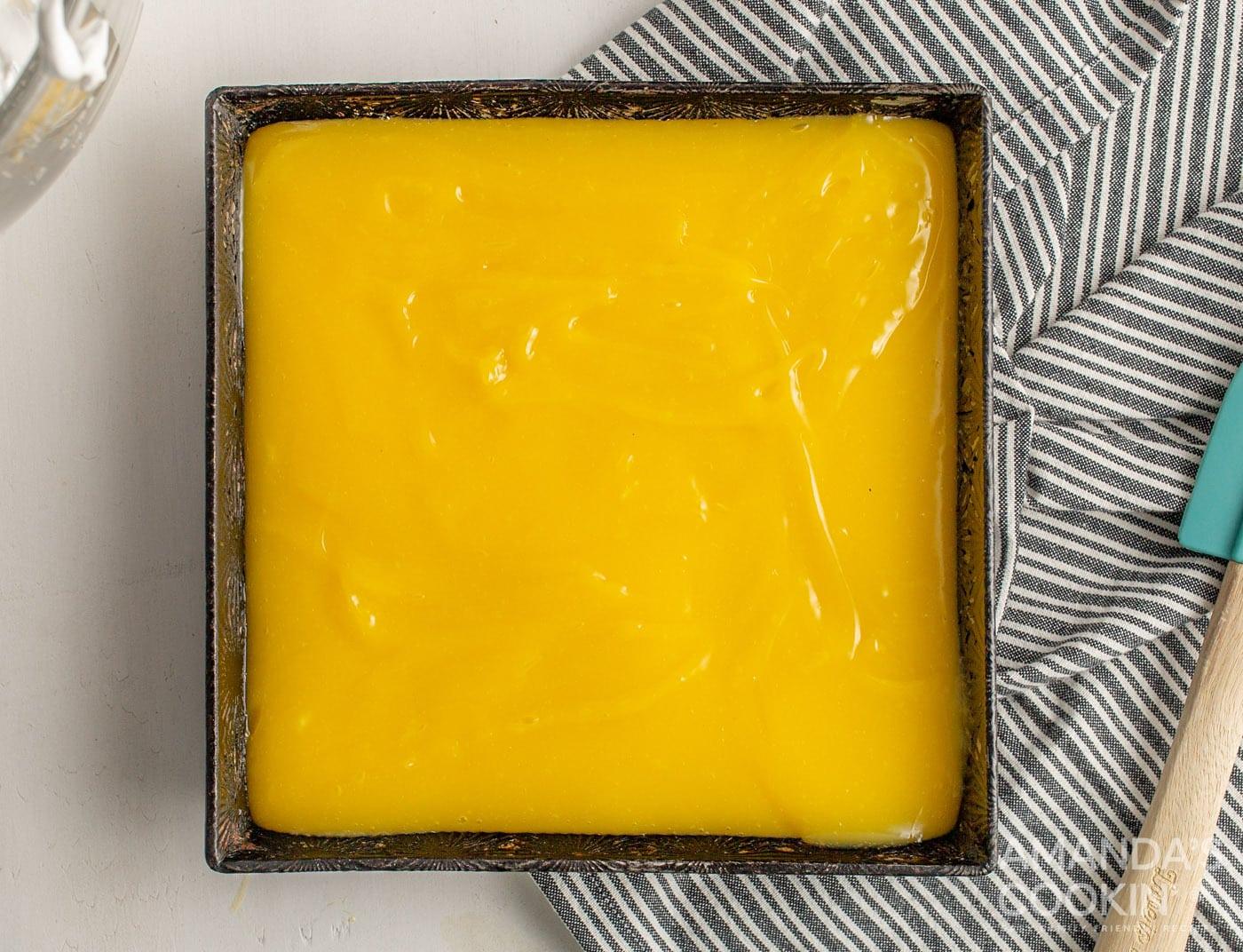 lemon mixture on top of crust in a baking pan