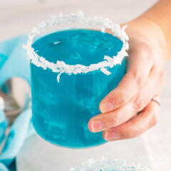 holding a glass of Ocean Water Cocktail