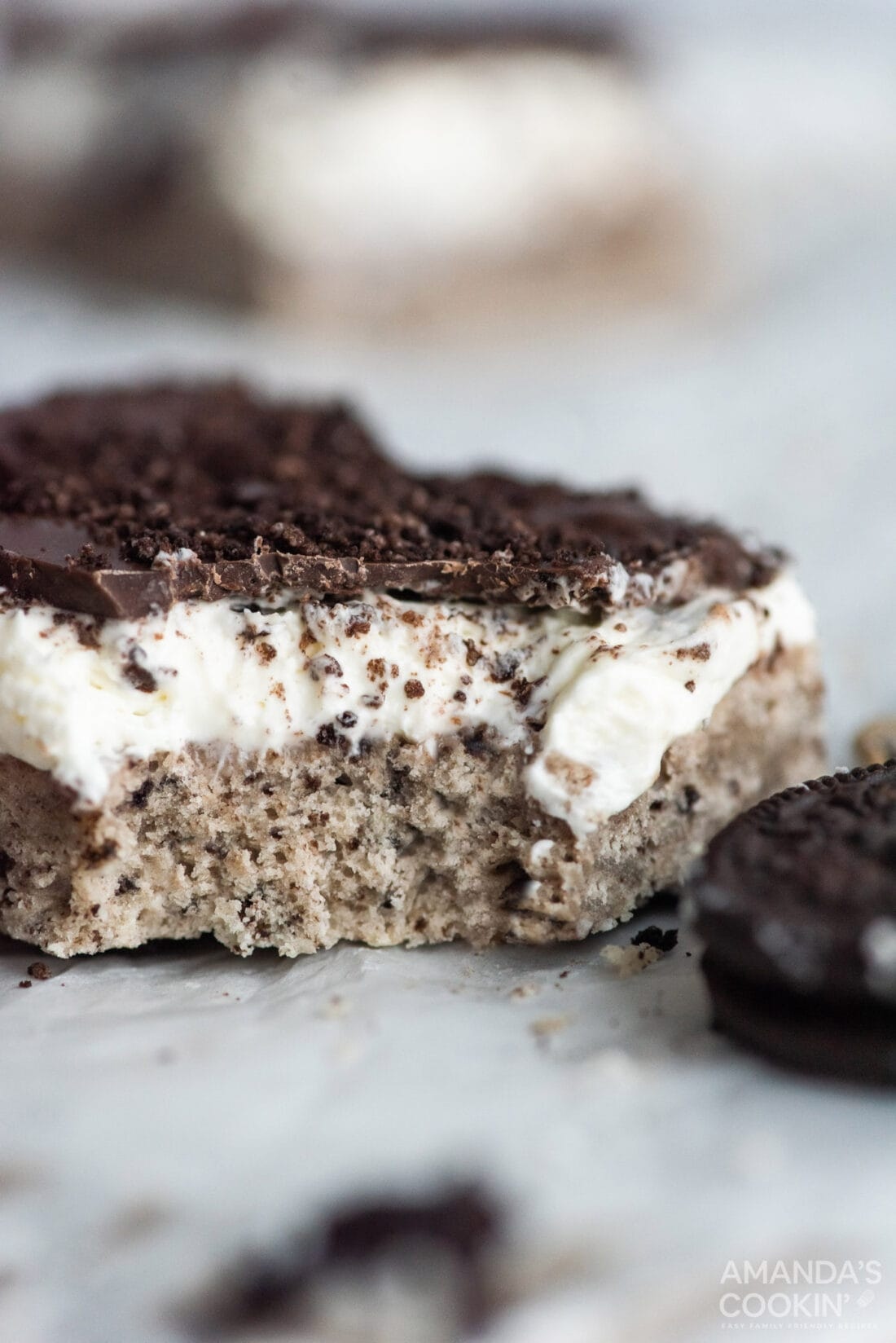 oreo cheesecake bar with a bite out of it