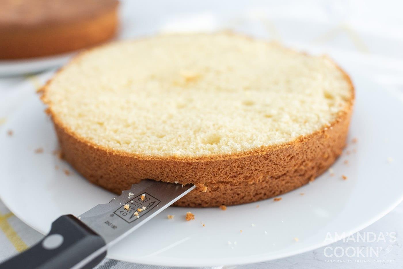 knife cutting cake in half