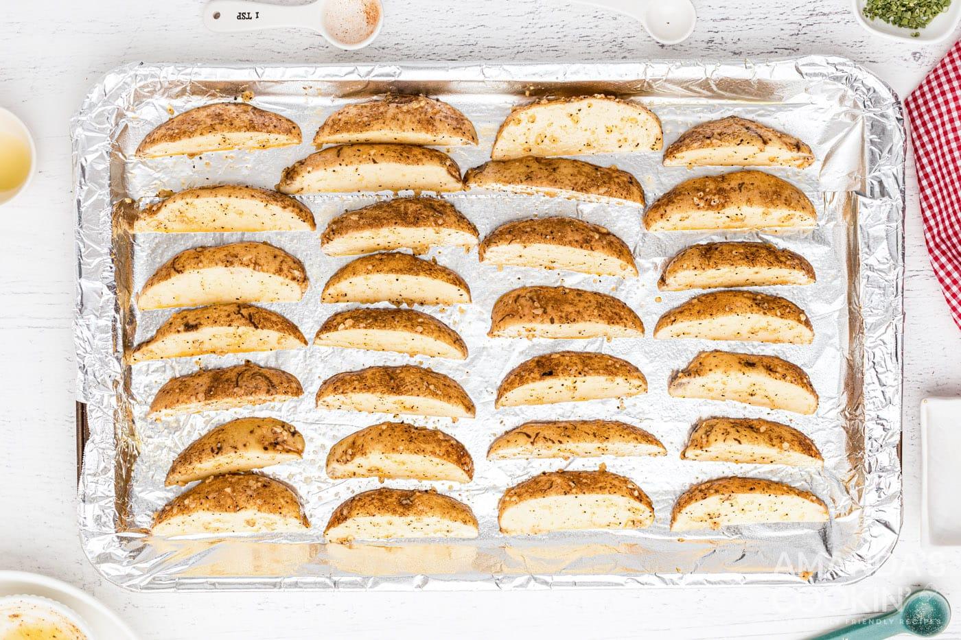 potato wedges on foil lined baking sheet