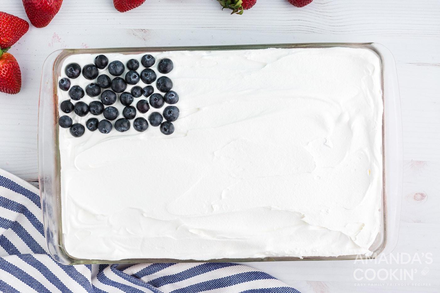 blueberries on top left corner of cake