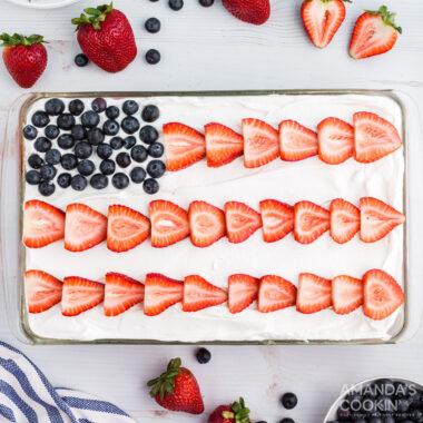 red white and blue poke cake decorated like a USA flag