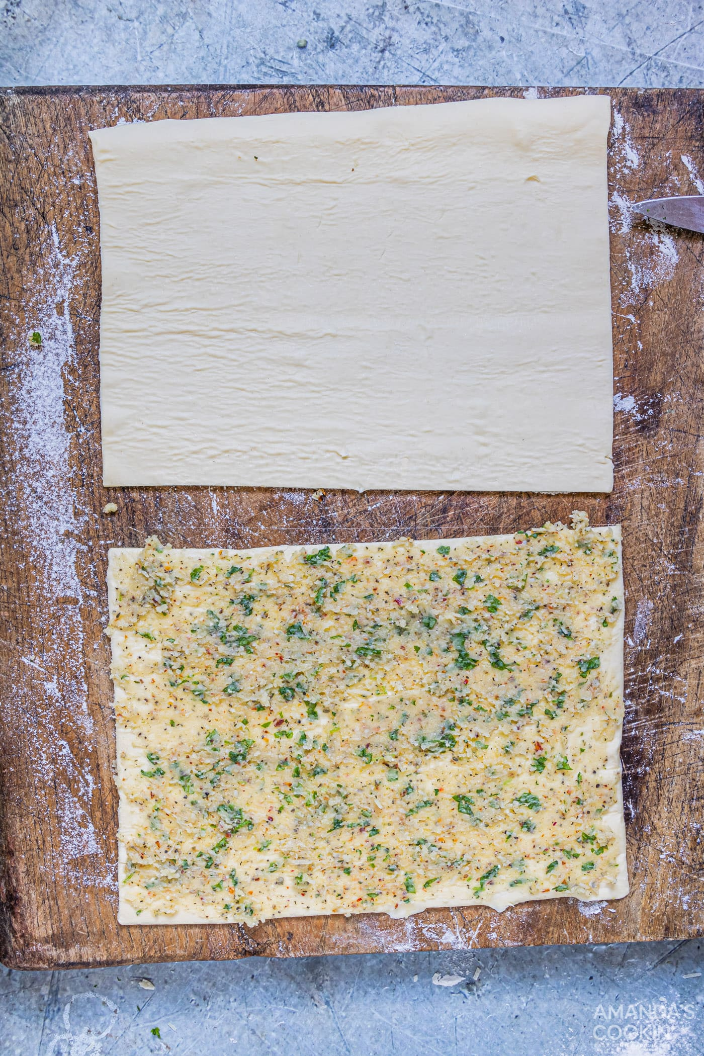 garlic butter smeared onto puff pastry sheet