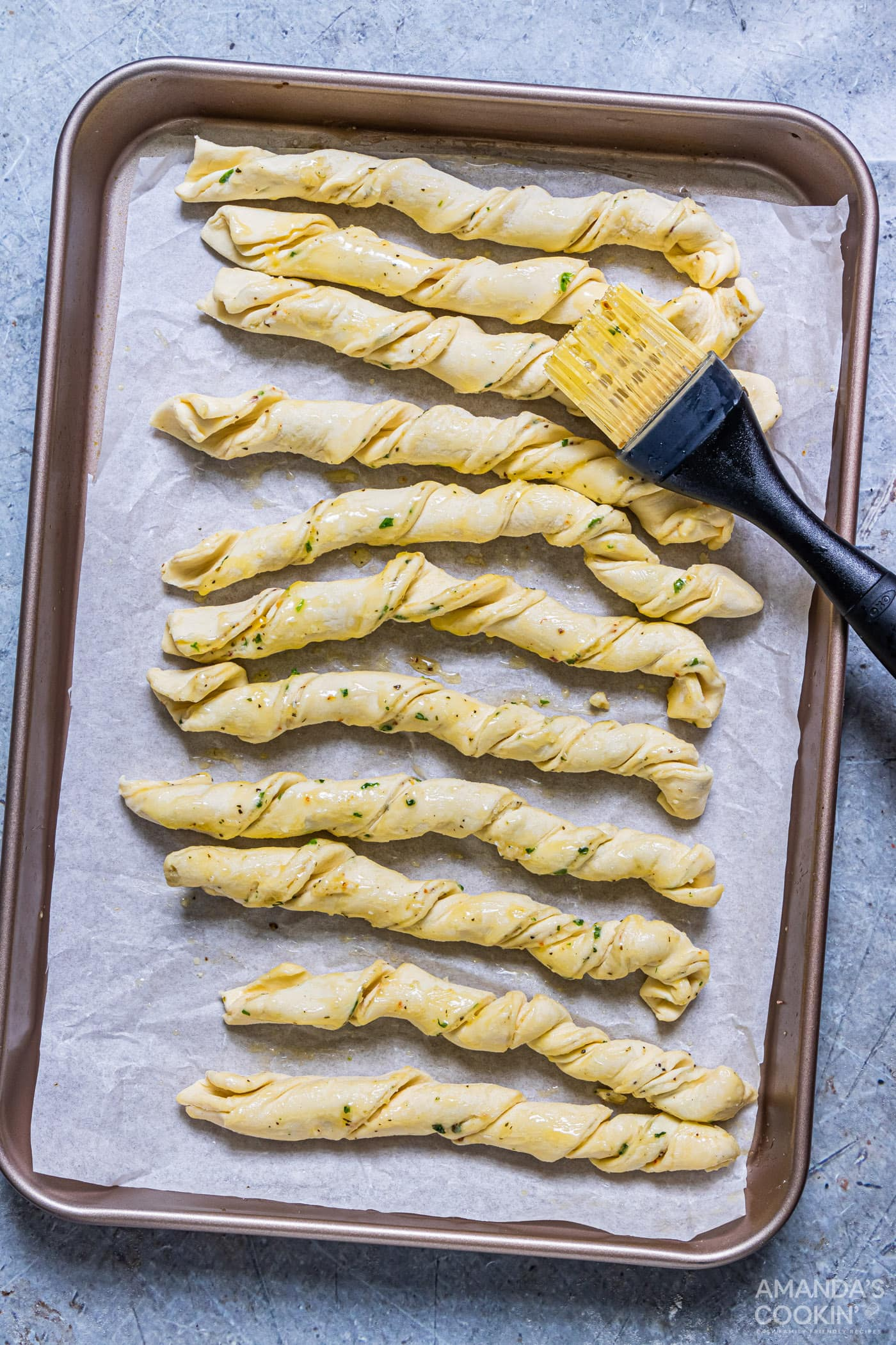 brushing parmesan twists with butter