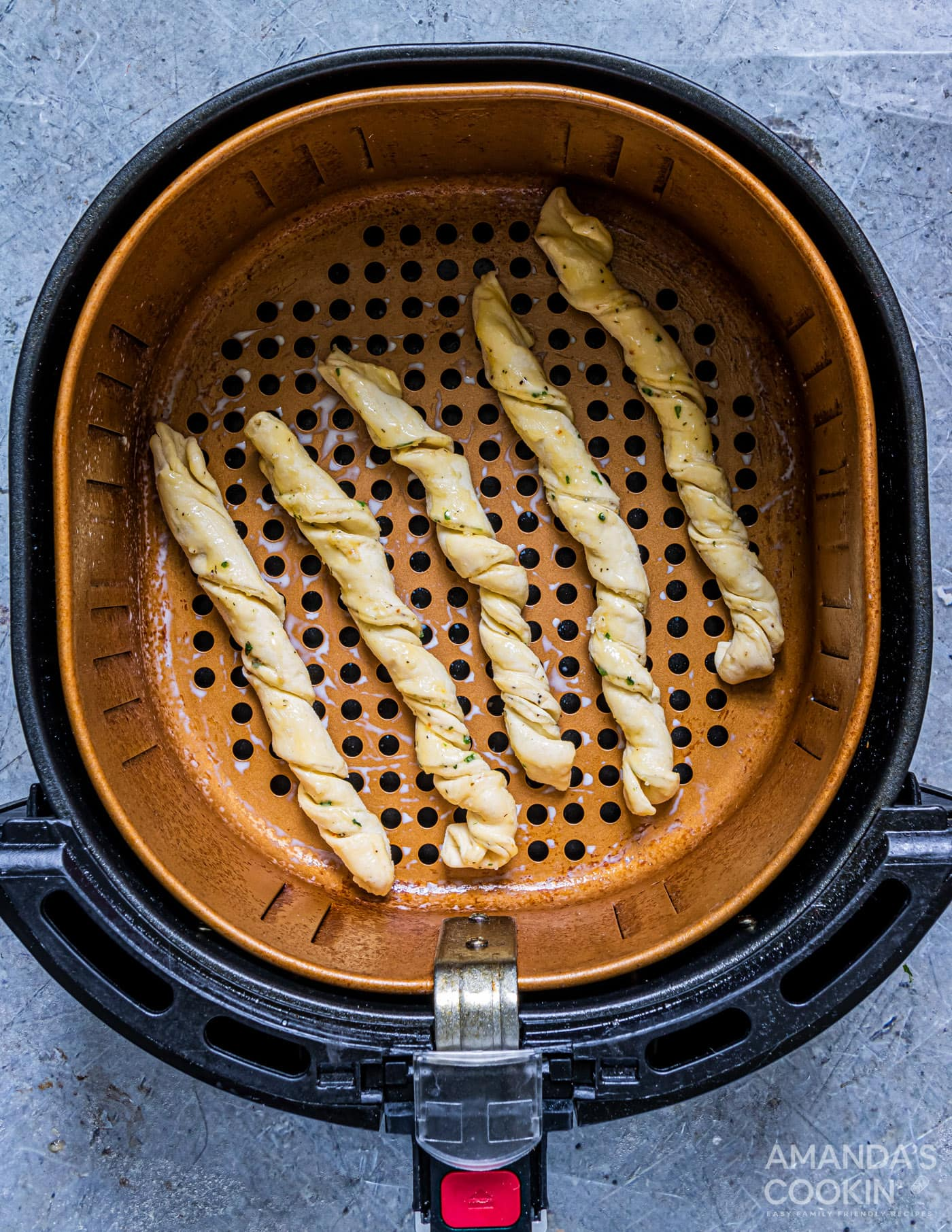 garlic parmesan twists in air fryer basket