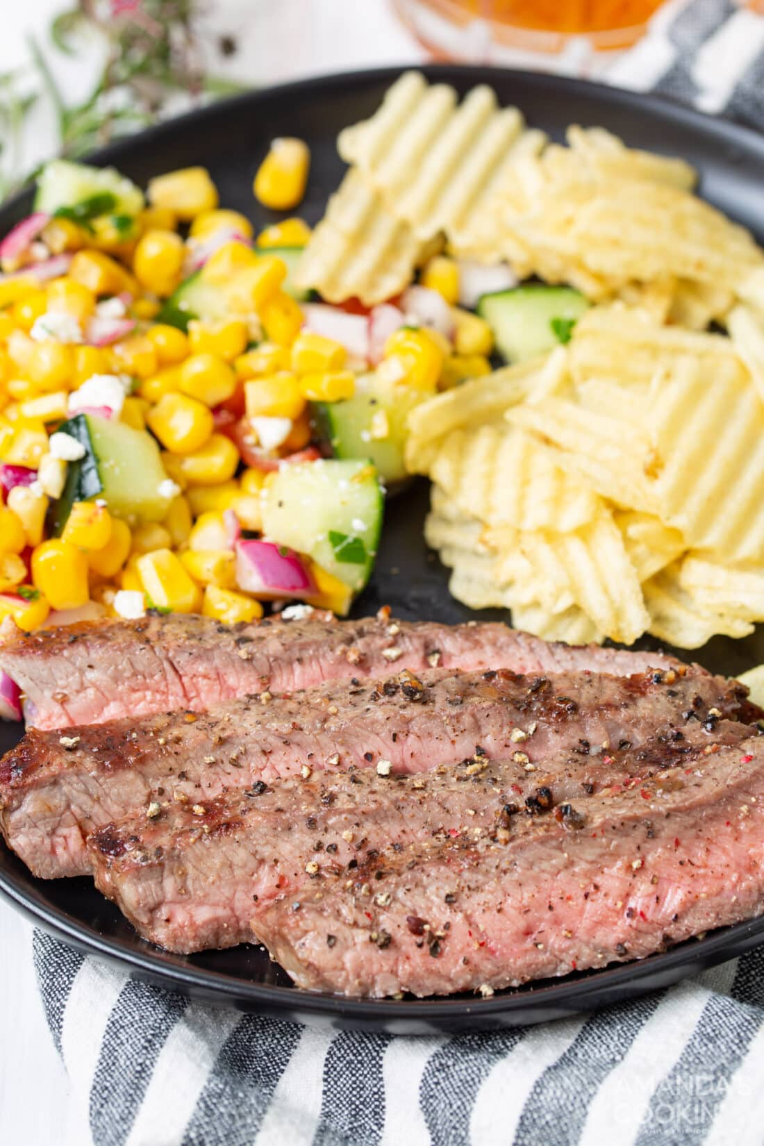 Grilled New steak on a plate with corn
