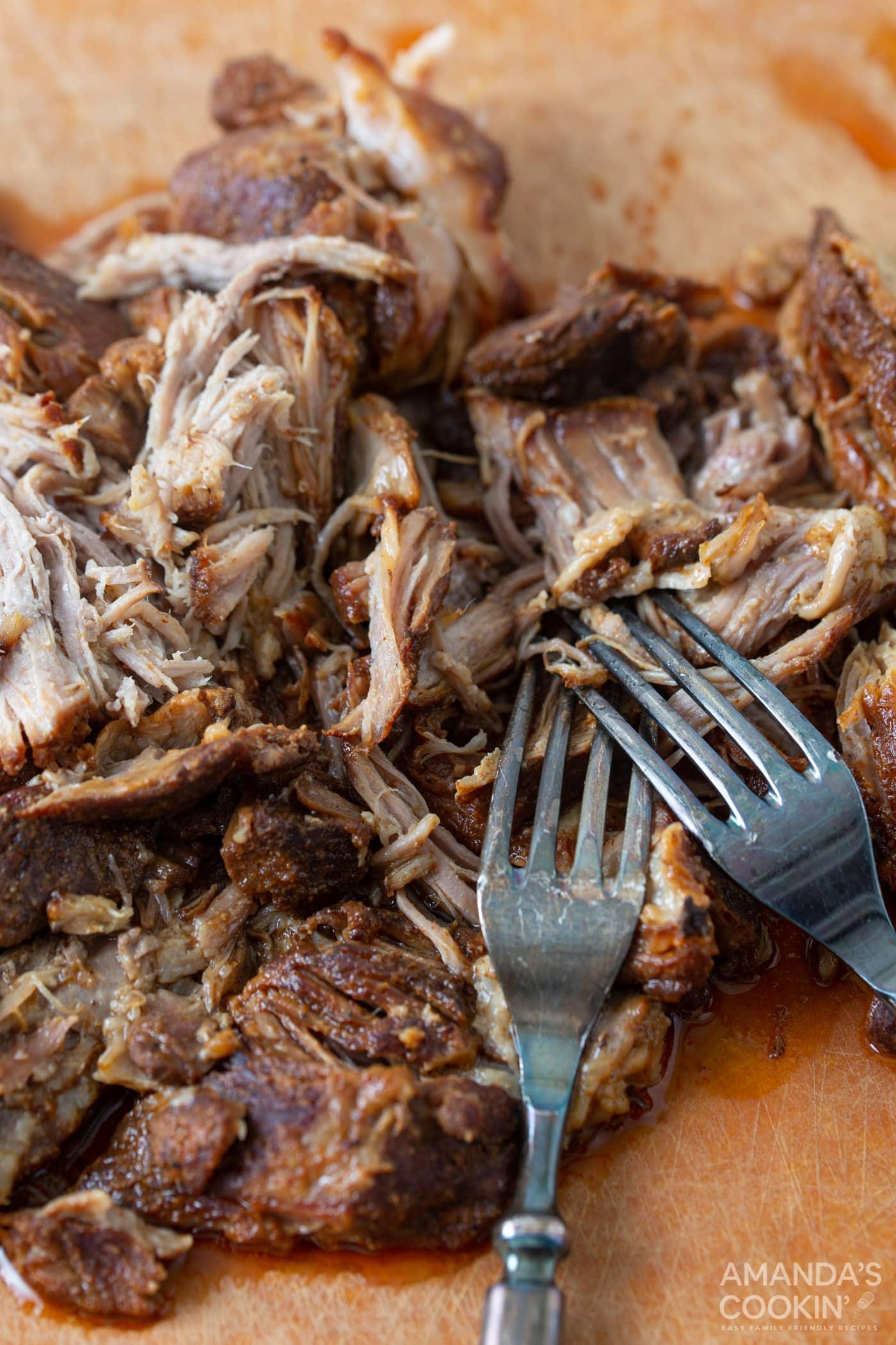 shredding pulled pork with forks