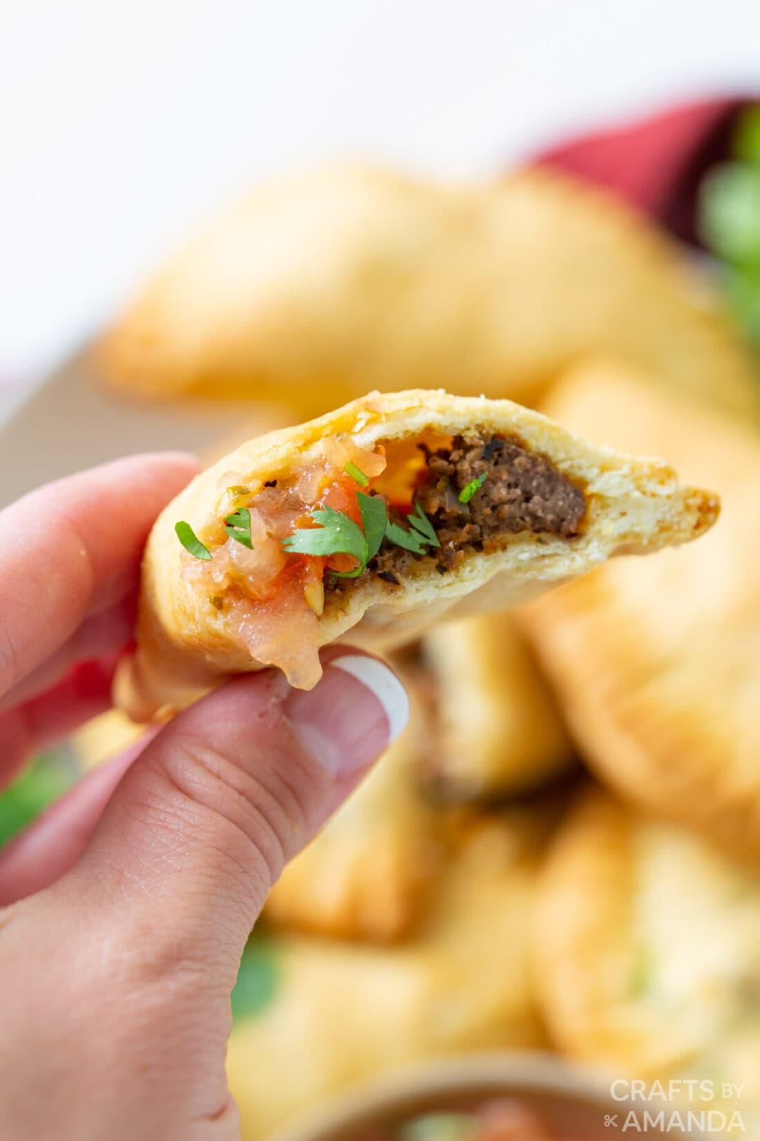 close up of inside of air fryer empanadas