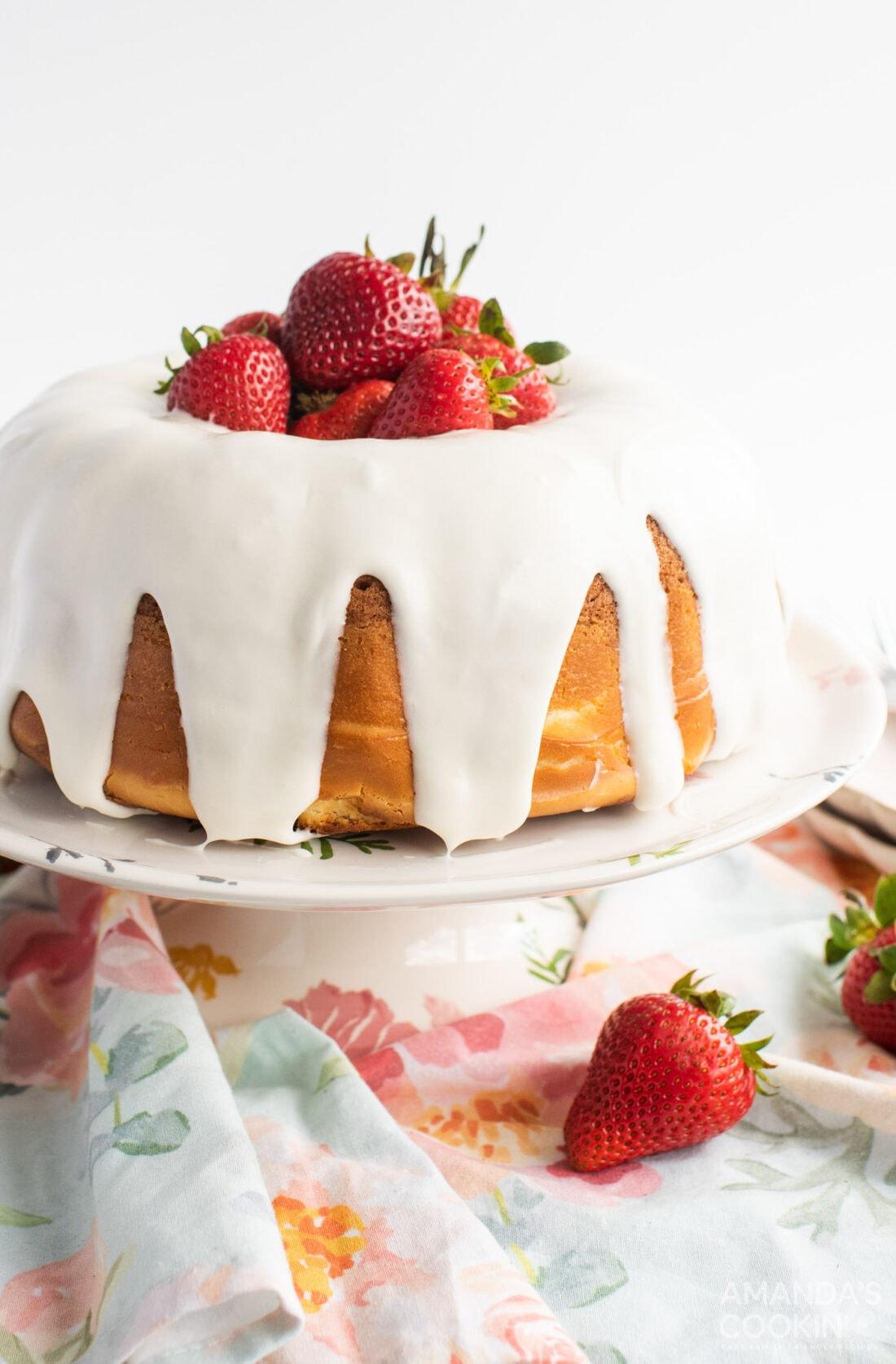 strawberry bundt cake on a cake plate
