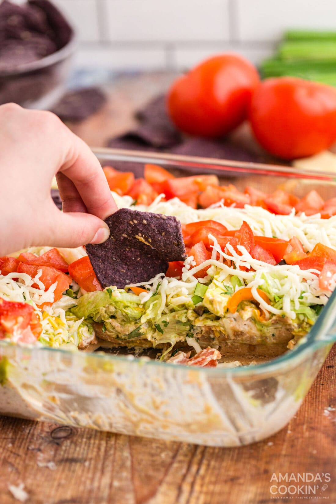 using chip to scoop taco salad