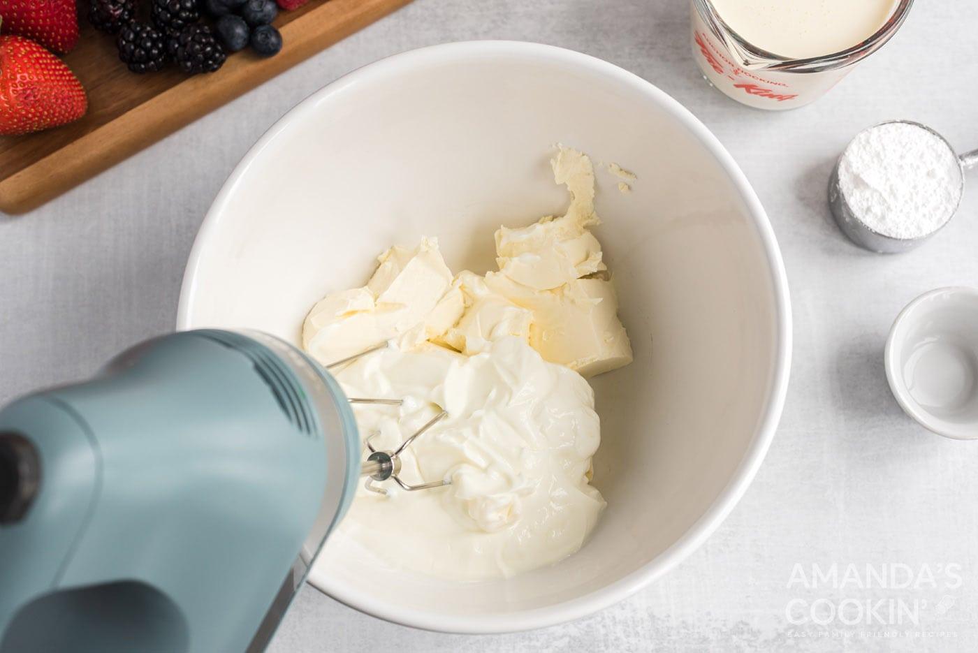 cream cheese and greek yogurt with hand mixer