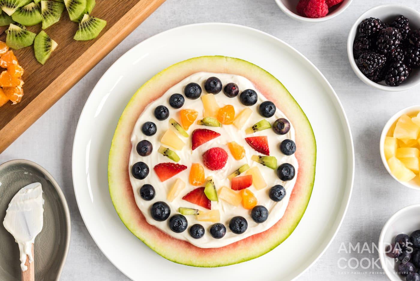 watermelon slice with fruit and cream cheese yogurt layer