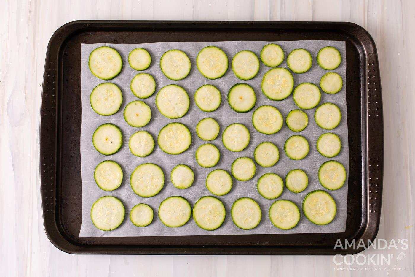 sliced zucchini on a sheet pan